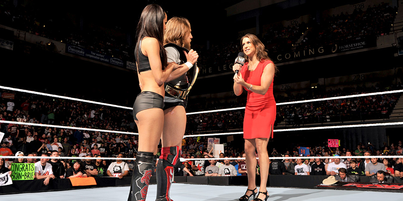 "Stephanie presents a ""wedding present"" to the Bryans — Daniel will defend the World Heavyweight Title against The Devil's Favorite Demon, Kane, at Extreme Rules! Photo Credit: WWE"