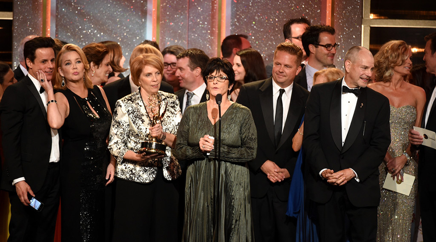Producer Jill Farren Phelps (C) with cast and crew accept Outstanding Drama Series for 'The Young and the Restless' onstage during The 41st Annual Daytime Emmy Awards at The Beverly Hilton Hotel on June 22, 2014 in Beverly Hills, California. Photo Credit: Michael Buckner/Getty Images