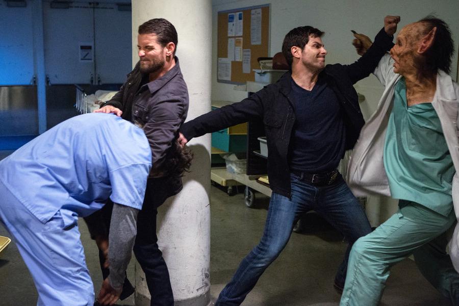 "GRIMM -- ""Rat King"" Episode 505 -- Pictured: (l-r) Damien Puckler as Meisner, David Giuntoli as Nick Burkhardt -- (Photo by: Scott Green/NBC)"