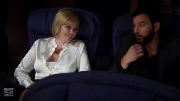 Ava is seated next to a familiar face on her flight to London.