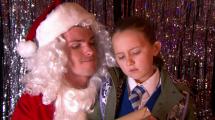 Santa Set gives Leah her tablet.