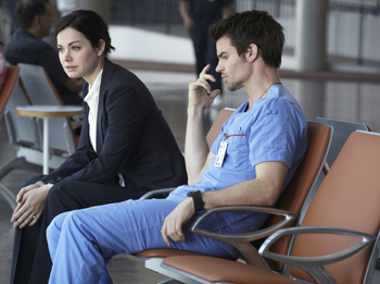 Erica Durance as Alex Reid, Daniel Gillies as Joel Goran