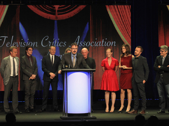 Creator Vince Gilligan (Speaking), (L-R) Executive Producer Mark Johnson, Actors RJ Mitte, Bryan Cranston, Co-Executive Producer Michelle MacLaren, Actors Jonathan Banks, Co-Executive Producer Melissa Bernstein, Actors Betsy Brandt, Aaron Paul and writer/producer Peter Gould accept the Outstanding Achievement in Drama Award for 'Breaking Bad onstage during the 28th Annual Television Critics Association Awards at The Beverly Hilton Hotel on July 28, 2012 in Beverly Hills, California.